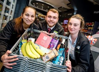 Midcounties Co-operative Food colleagues Roxanne Cercel, Karl Shellam and Sam Chesters with some of the Fairtrade products available at the Midcounties Co-operative Food