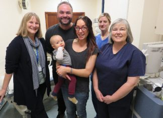 Annie and Mark Hambley with their son Bodhi and staff at the Shropshire and Mid Wales Fertility Centre