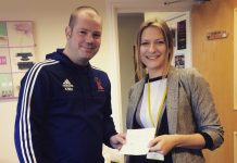 Club secretary Kevin Hamer handing over a cheque to Emily Jones from Hope House