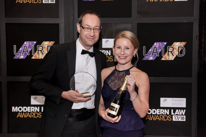 Sales Director Neil Lloyd and Marketing Manager Laura Jones receive the Outstanding Commitment to Training Award at the Modern Law Awards