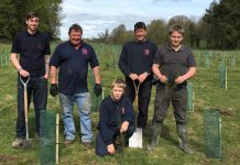 Planting the Tudor Griffiths Group trees are, from left, Maccrea Evans, Garry Lloyd, Oliver Griffiths, Kevin Jones, and Harry Griffiths