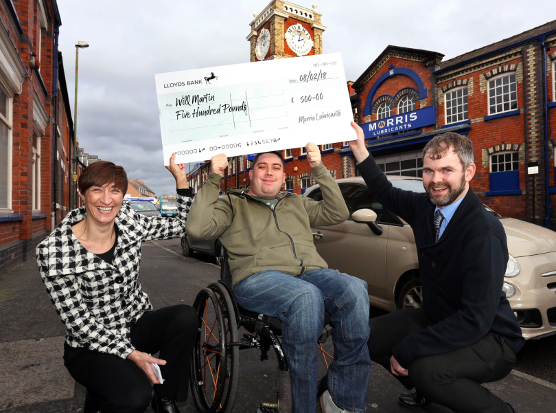 Will Martin receives a cheque for £500 from Gina Hinde and Andrew Simms of Morris Lubricants