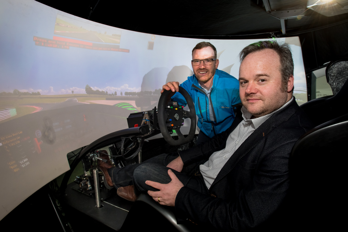 Anton Gunter from Global Freight with Tim Luft from VR Simulation Systems (seated) in one of the simulators