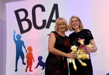 Author Lorna McCann receives Best Children's Product Award 2018 from BCA sponsor Trish Parsons, owner of Bellini's Box