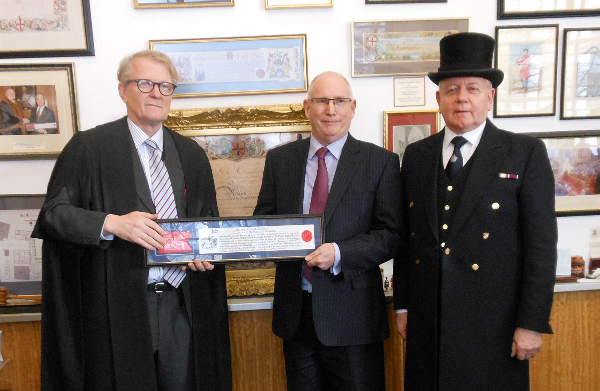 Steven Corfield (centre) receiving the grant from the Clerk to the Chamberlain Murray Craig (left) watched by Ernest Brocklehurst (right), Beadle to the Chamberlain's Court