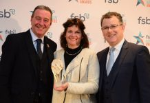 Jacqueline Champion (centre) collects the Family Business of the Year award from Paul Reeves, Head of Customer Banking, Birmingham, CYBG (Left) and MC Dave Sharpe