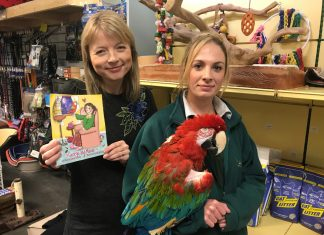 Author Sarah Griffiths meets Poncho, being held by Emma Small at Beck's Pets and Exotics in Shrewsbury