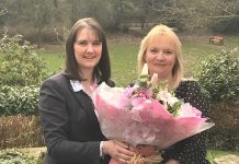 General Manager Jo Boddison presents and mum of the year winner Jude Ayling-Whitehouse with a bouquet of flowers