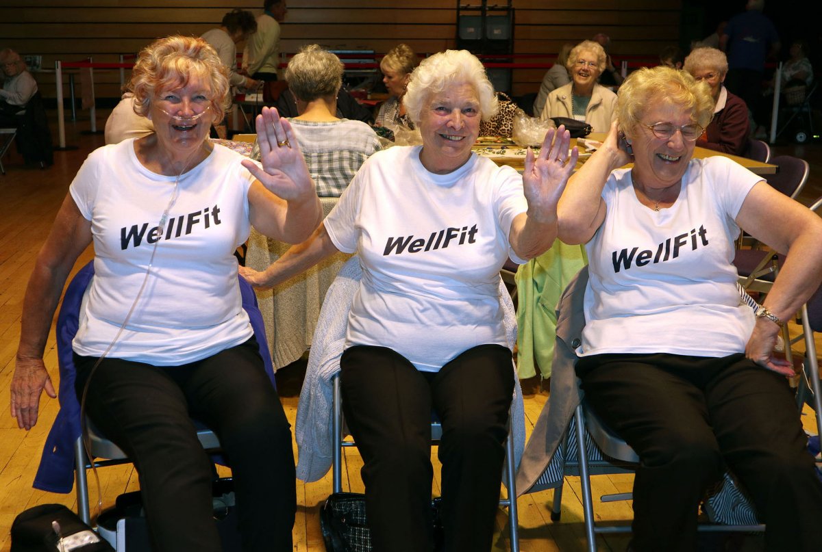 Dian Whittingham, Mavis Lamb and Mary Stanworth getting involved in a WellFit demonstration at the 2017 festival