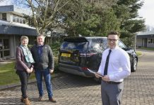 Young apprentice Ashley Roberts with Gareth and Joy Evans and their new Discovery