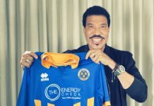 Lionel Richie pictured holding a club shirt