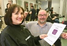 Pictured, Shrewsbury dental nurse Maria Maddox, who had over 12 inches of hair cut off for the charity, with Gavin Pulham of Toni & Guy