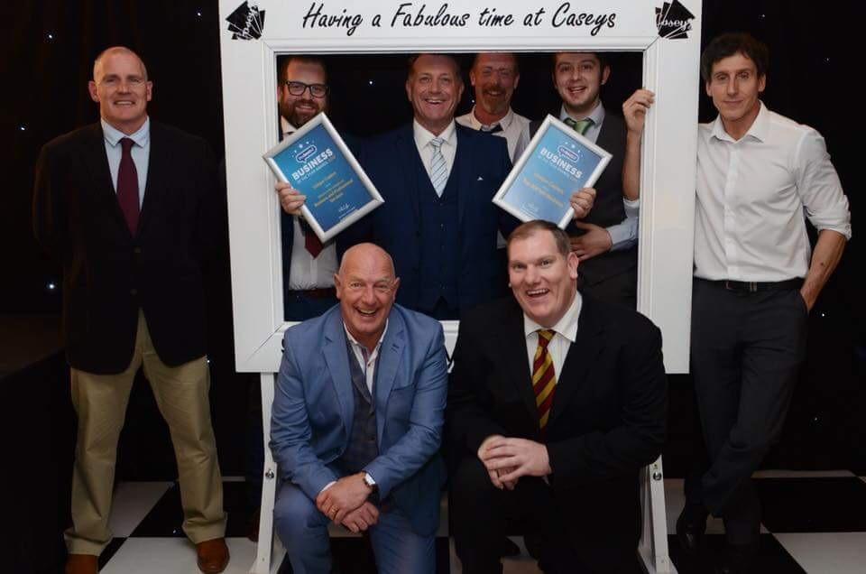 Adrian Casey pictured centre with the certificates and the rest of the Unique Copiers team