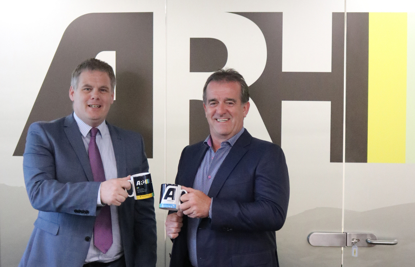 Ian Harvey, Senior Account Manager and Tony Holton, Managing Director for ARH Group celebrate the multi-million contract