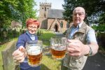 Mary Thomas, Vicar at St Mary Magdalene and Frank Aston, one of the volunteers, get ready for this weekend's Beer Festival