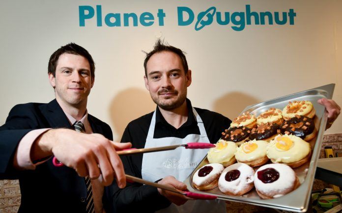 Checking out the doughnuts is Adam Davies of FBC Manby Bowdler and Duncan McGregor, Planet Doughnut