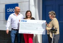 Gavin Mills and Zoe Ashbridge of Clear present the cheque to Ruby Hartshorn, Chair of Shropshire Disability Network