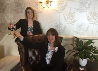 Melissa Jordon, receptionist, celebrates the new reception with Best Western Valley Hotel general manager Jo Boddison
