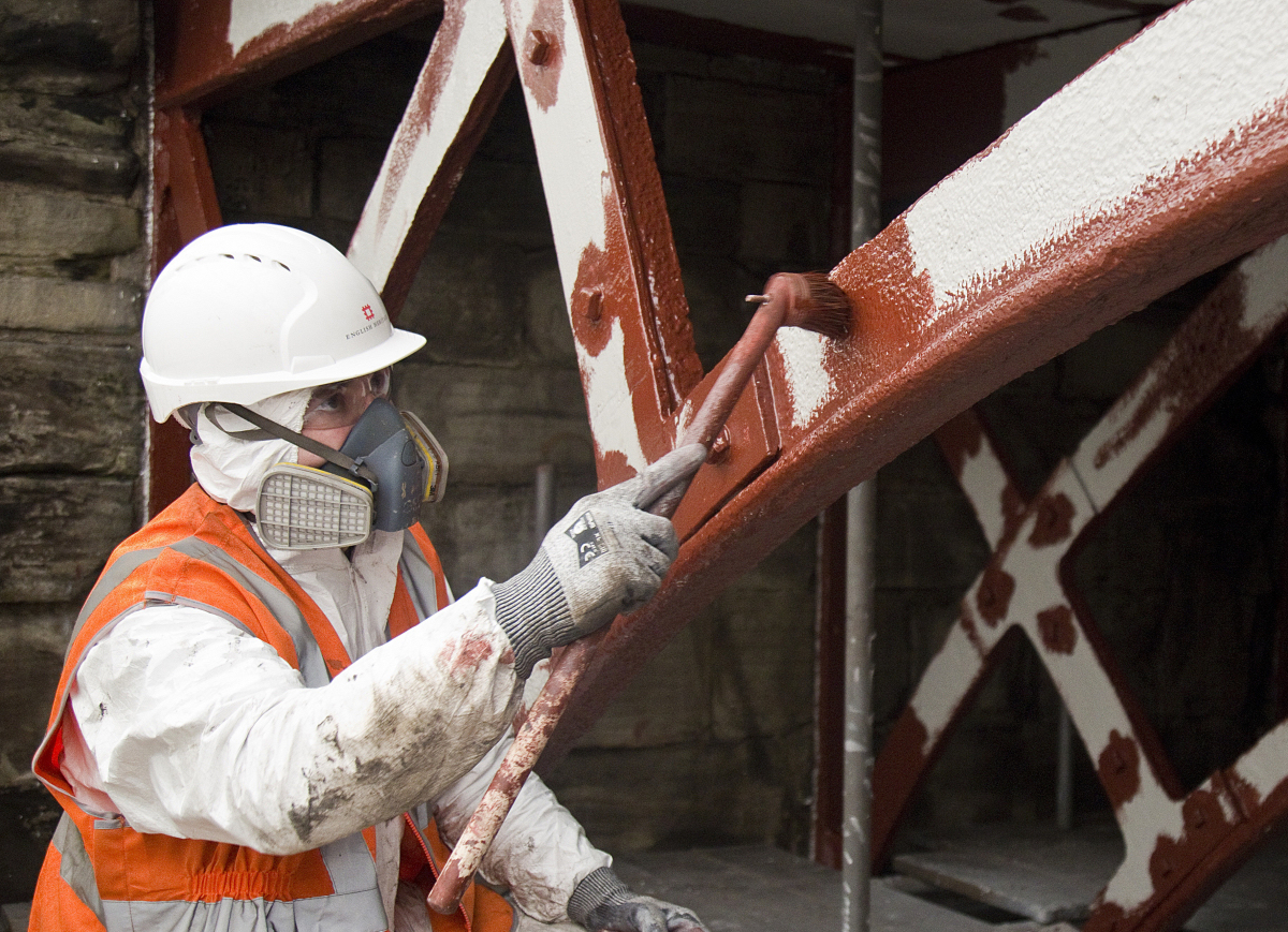 A team of six painters are painting the bridge using 2,400 litres of paint, which will protect the historic ironwork in a similar way to the paint system used on the Forth Bridge. Photo: English Heritage