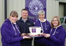 Pictured with the anniversary cake are Sarah Carter, Adrian Dratwinski, Diane Nelson and Ruth Jones