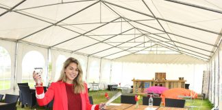 Event organiser Vivienne Stevens in the temporary visitor hospitality area at Hencote Estate vineyard, Shrewsbury