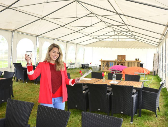 Event organiser Vivienne Stevens in the temporary visitor hospitality area at Hencote Estate vineyard, Shrewsbury