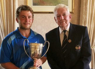The SHUGC President Ernie Wilks presenting The Amateur Championship Trophy to Callum Brown
