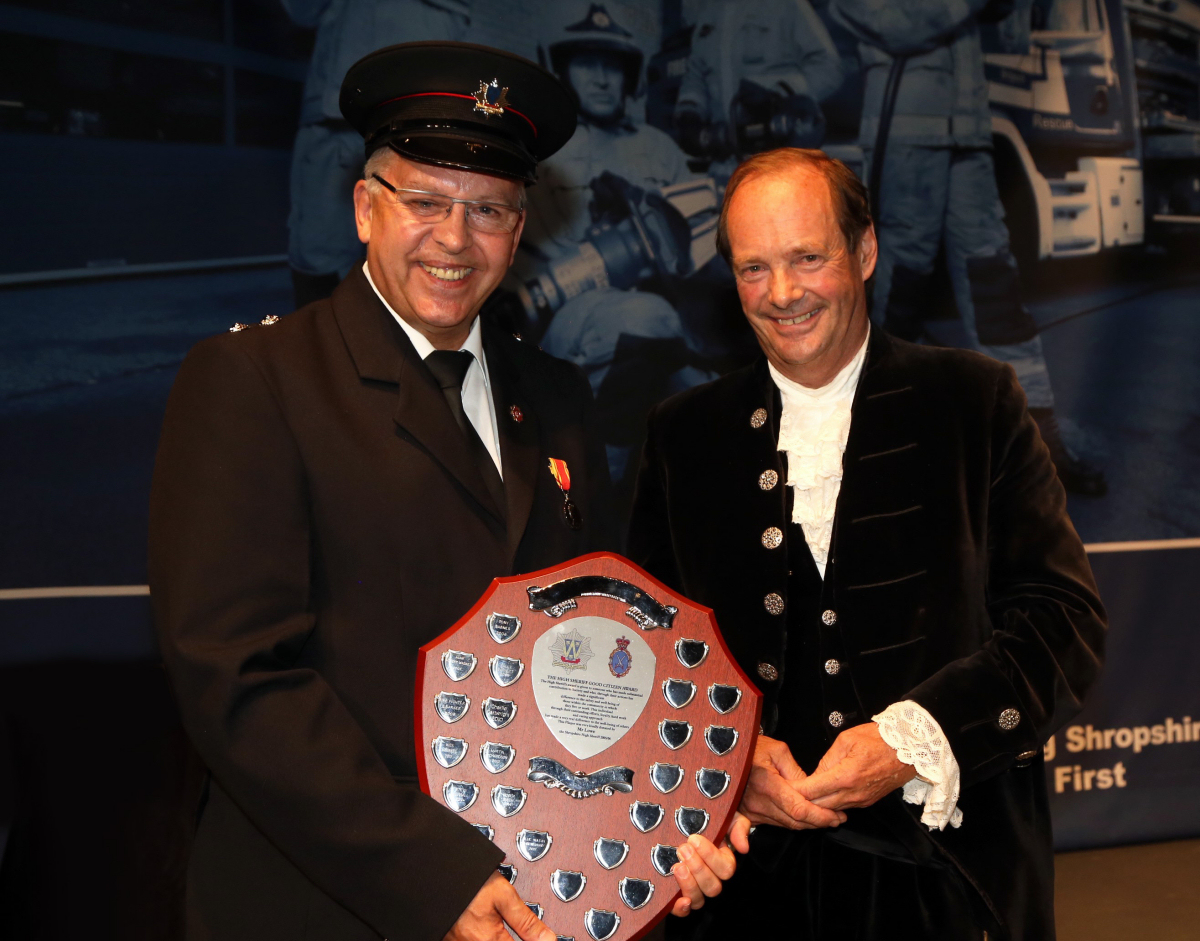 Shrewsbury fire control operator Paul Pryce receives the good citizen award from Shropshire High Sheriff Rhoderick Swire