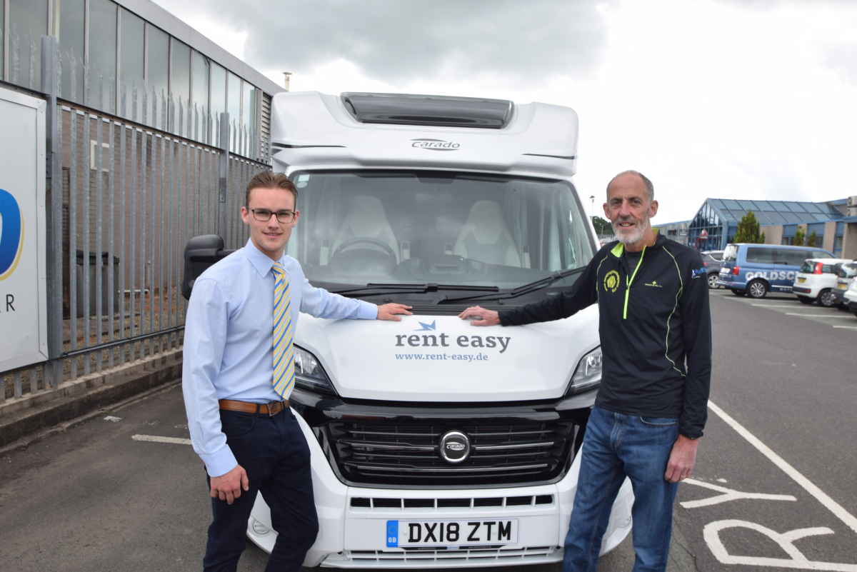 Keith Robins and Harry Price with the motorhome
