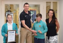St Laurence's Primary receives its award. Harry Cade of Energize is pictured with pupils Chloe Williams and Thomas Martin, plus PE co-ordinator Sacha Lee