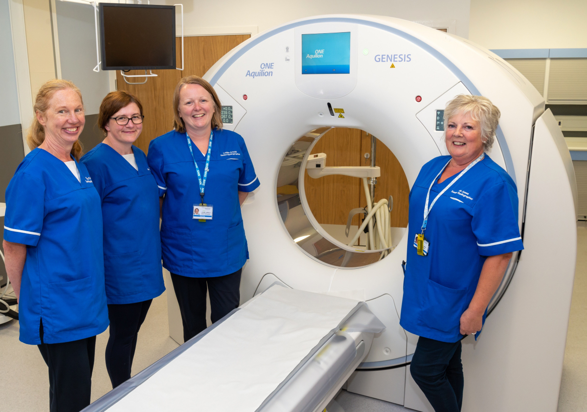 From left, Dawn Collins, Superintendent Radiographer; Sue Pierson; Senior Radiographer; Louise Arnold, Senior Radiographer; and Val Jones, Senior Radiographer; with the new CT scanner