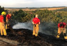 Firefighters work to put out the fire on Lilleshall Hill