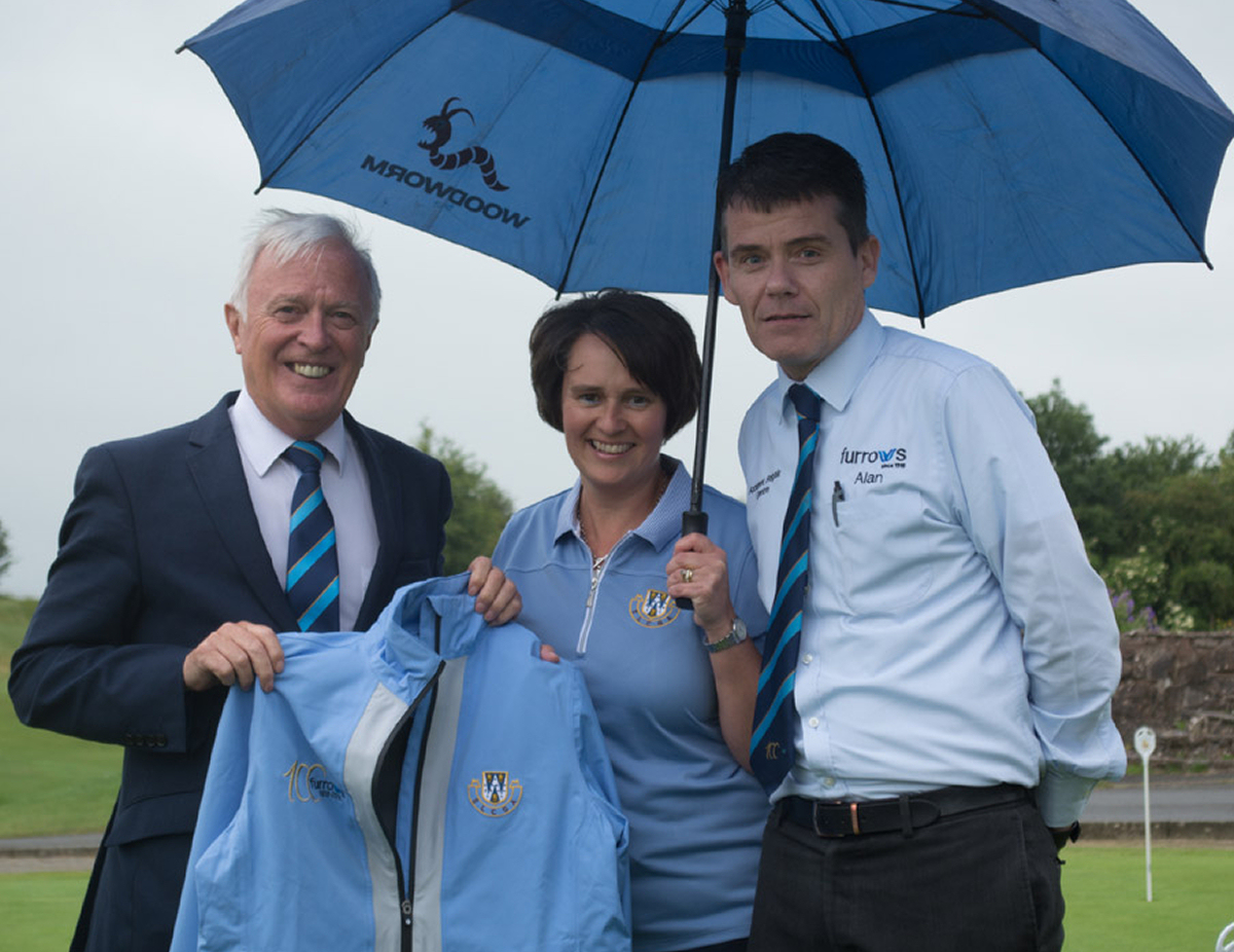 Furrows joint managing director Russ Smith (left) and Accident Repair Centre Manager Alan Clavin (right) present the jackets to Anne Weetman, Shropshire County Captain