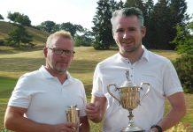 Marc Lang holding the Dickson Handicap Trophy and Steve Fitzpatrick (2018 Club Champion) holding the Wetton Scratch Cup