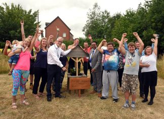 Residents, staff including Chief Exec Pete Richmond and the Mayor of Telford and Wrekin launching the new Community Garden