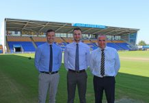 Salop Leisure's marketing manager Ed Glover (centre) with Shrewsbury Town's commercial manager Andy Tretton (left) and chief executive Brian Caldwell with the Salop Leisure stand in the background