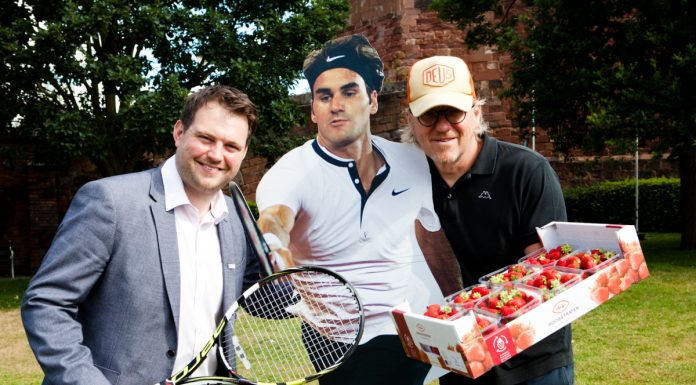 Seb Slater from Shrewsbury BID, with a cardboard cut-out of Rodger Federer and Des Walker from Pomona