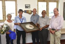 Unveiling the commemorative plaque and holding the presidents salver, are from left, Pauline Trimble, Annie Goodyear, past president Garth Weaver, club chairman Steve Layton and Sir Michael Leighton