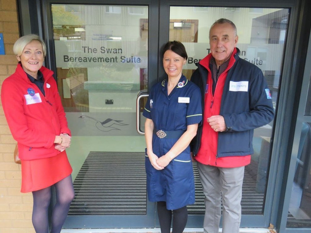 Jules Lewis (centre) with Dr Terri Porrett and Roy Lilley from the Academy of Fabulous NHS Stuff outside the Swan Bereavement Suite at RSH