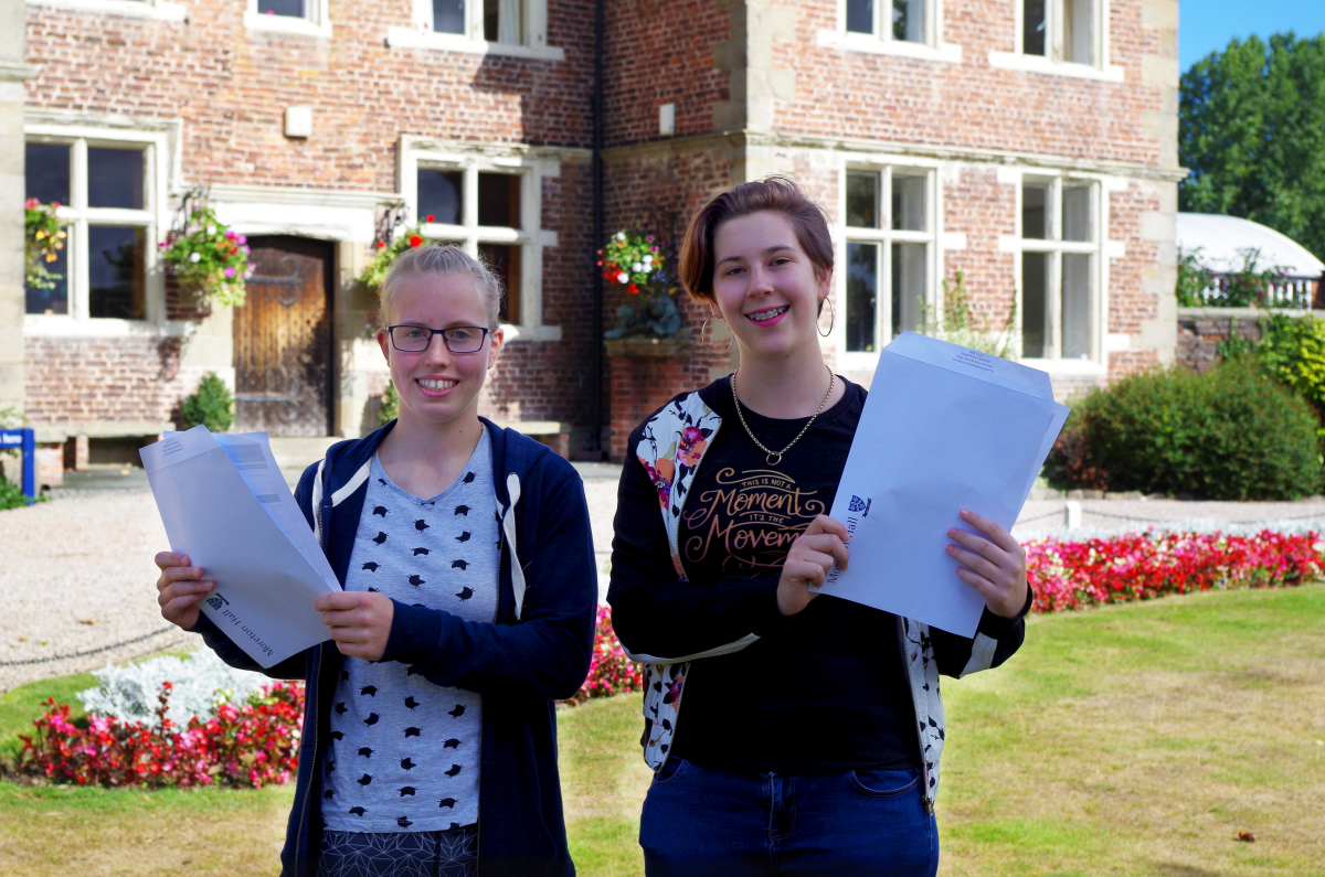Moreton Hall students Holly Jones who achieved 2 A*s and 1 A and Georgina Lang who achieved four A*s