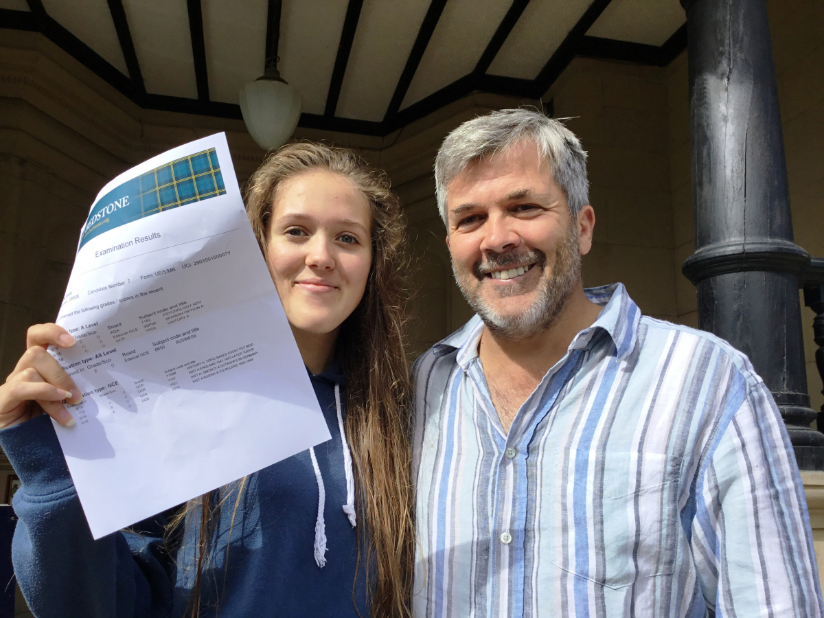 Emily Forman a student at Bedstone College celebrates her results with her dad, Dr David Foreman
