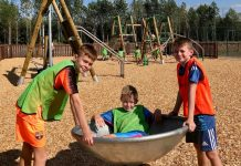 Children having fun at The Shrewsbury Club's new outdoors play area