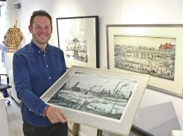 Jonathan Soden is pictured with the three limited edition original lithographs by L S Lowry which are on show in his gallery in Shrewsbury