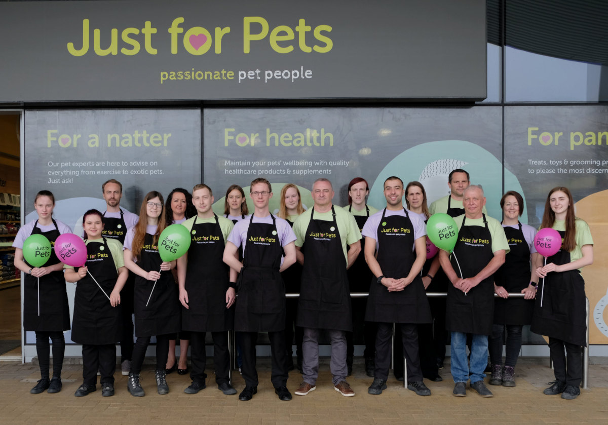 The just for pets team outside the refreshed store