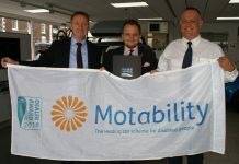 The Motability award to Arthurs Vauxhall included the presentation of a new flag proudly held by (left to right) Simon Foulkes, William Edwards and Arthurs Vauxhall Retail Operator David