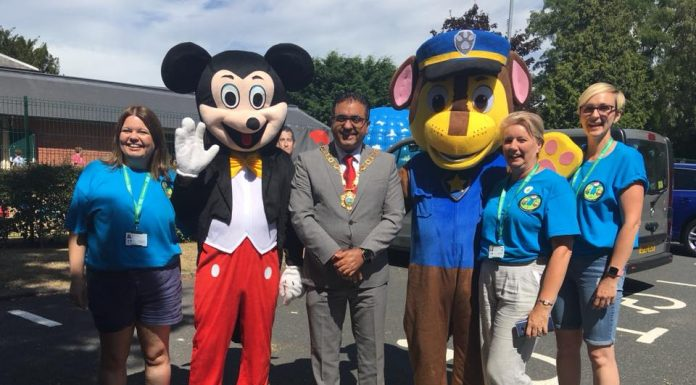 Celebrating the anniversary at a picnic event are Elaine Pearce (Project Officer), Andy Pearce (aka Mickey Mouse), Mayor Councillor Raj Mehta, Lee Stevens (aka Chase), Jayne Stevens (Participation Co-ordinator) and Kerrie Seagrave (Project Administrator)