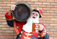 Shrewsbury town crier Martin Wood gets ready for the event