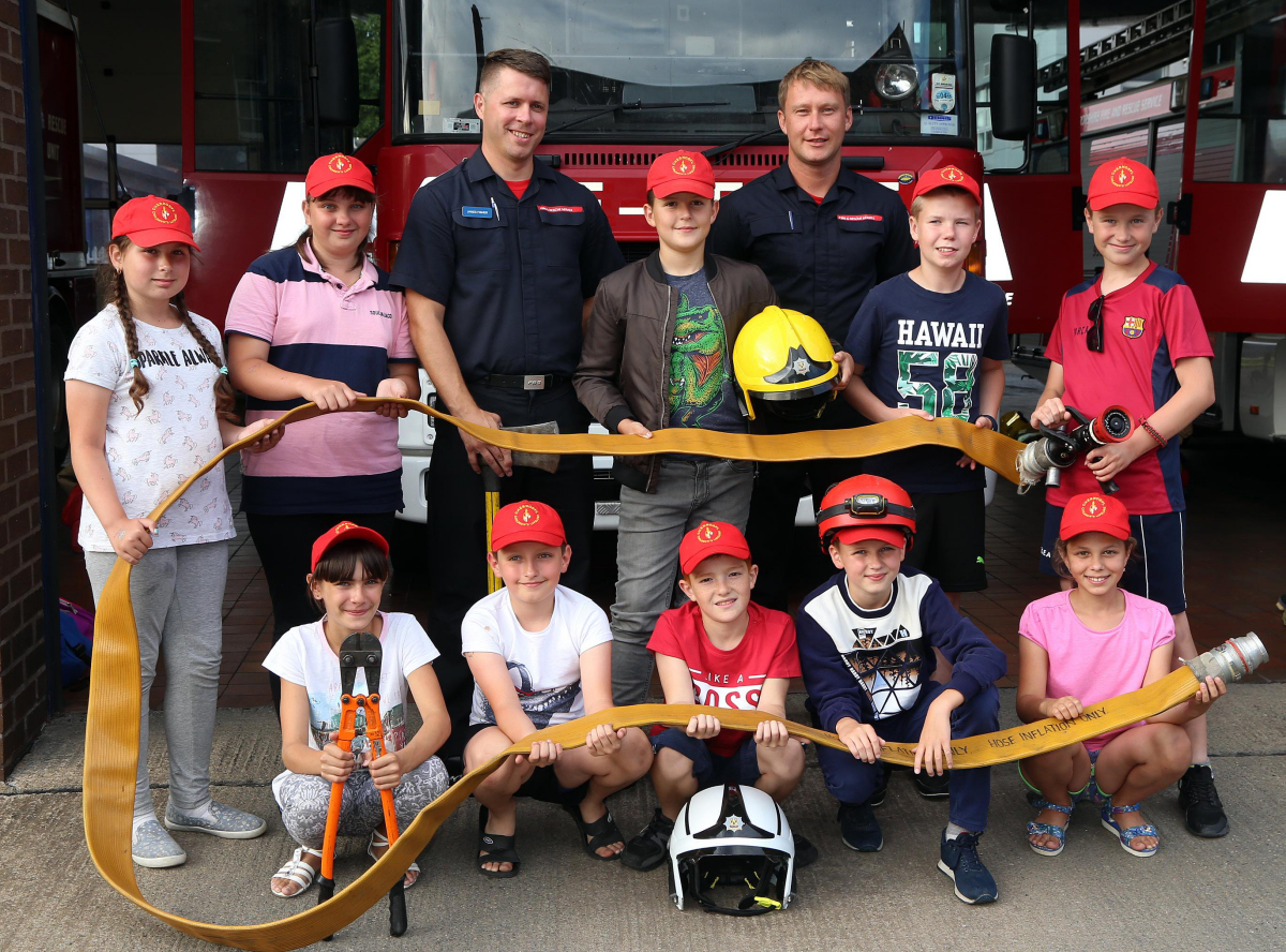 Chernobyl children had fun at Shrewsbury fire station. Pictured with firefighters James Fisher and Andy Davies