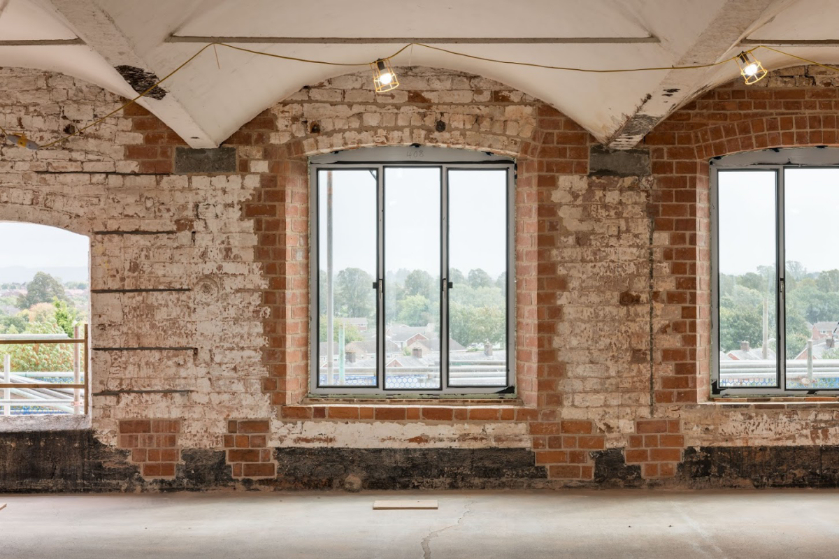 An interior view of the fifth floor with scaffolding removed and metal framed windows installed. Photo: Historic England