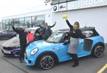 Adding a shine to two of the display vehicles are Matt Smart, Dean Shum and Georgie Dixon, at Rybrook BMW of Shrewsbury